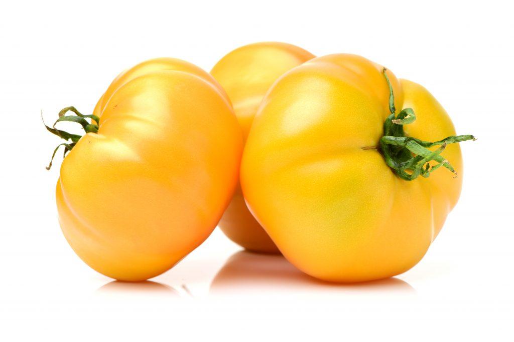 Томат Гигант лимонный: характеристика и описание сорта, урожайность с фото